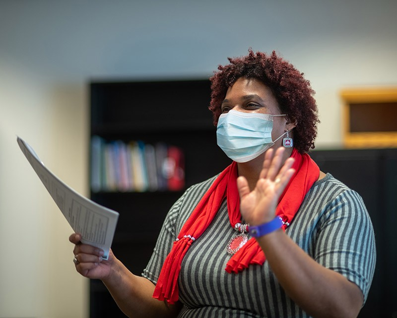 Faculty of Ohio State speaking while wearing face mask