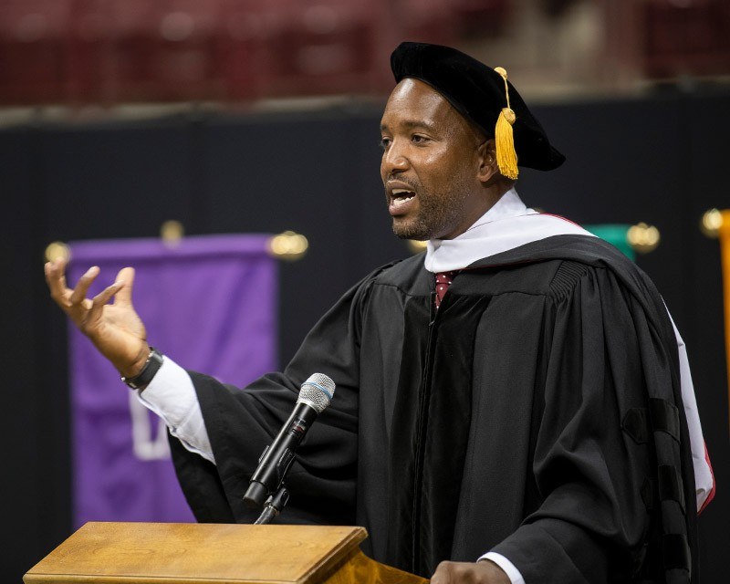 Michael Reed speaking at commencement ceremony